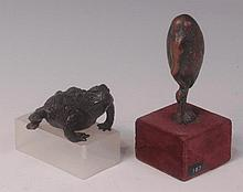 A contemporary bronze model of a frog, in