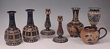 A pair of Doulton Lambeth stoneware bottle vases,