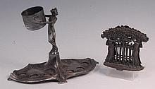 A WMF Art Nouveau pewter figural liqueur stand,