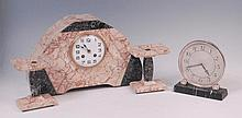 An Art Deco variegated marble three piece clock