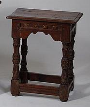 An early 18th century oak joint stool, having