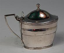 A George III silver mustard pot, with blue glass