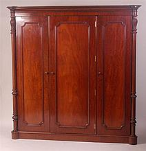 An early Victorian mahogany triple wardrobe,