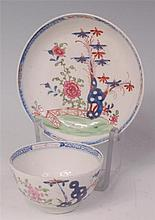 A Lowestoft porcelain teabowl and saucer,