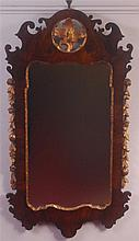 A Chippendale style figured walnut and parcel gilt