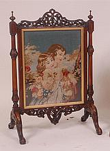 A Victorian rosewood fire screen, with scroll