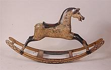 A circa 1900 childs dapple-grey rocking horse,