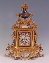 A 19th century French ormolu and porcelain inset