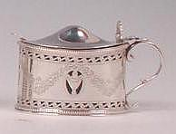 A George V silver mustard pot and cover, of