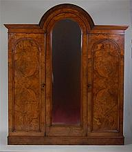 A Victorian figured walnut dome-top wardrobe, of