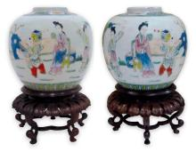 A pair of famille rose porcelain jars with hardwood stands