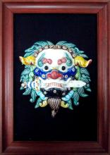 A polychrome stoneware lion mask