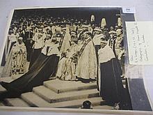 Small folio containing eight original photographs of Queen Elizabeth II Coronation