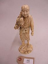 19th Century Japanese carved ivory figure of a man, 8ins high (a/f)