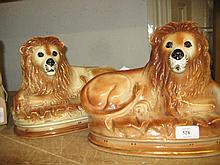 Pair of 19th Century Staffordshire figures of recumbent lions with glass eyes