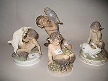 Royal Copenhagen figure of a kneeling faun with a parrot together with three similar smaller figures, each with a frog, rabbit and goat