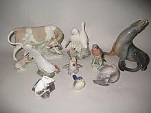 Lladro figure of a cow suckling a pig, together with eight other various Royal Copenhagen and Bing & Grondahl figures of animals and birds
