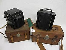 Large collection of miscellaneous cameras and photography related accessories including two Ensign plate cameras