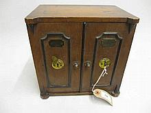 19th Century oak tea caddy in the form of a safe with two doors enclosing three small drawers