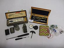 Cased set of drawing instruments, small hand signalling mirror, a monocular lens and other various small collectables including a harmonica