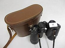 Pair of 12 x 50 binoculars in a leather case