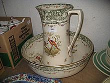 Large Royal Doulton jug and basin decorated with floral swags and Asiatic pheasants (jug restored)