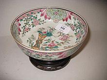 Small 20th Century Canton famille rose bowl on a hardwood stand, 6ins diameter