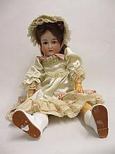 Armand Marseille bisque headed doll with open eyes and open mouth with four teeth, stamped 390 having articulated papier mache body, 24ins high