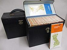 Two boxes containing a collection of various Bartholomes 1/2in maps and three 20th Century models of sailing ships