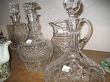 Two cut glass ships decanters, two other cut glass decanters and a similar jug