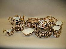 Royal Crown Derby Imari pattern twenty eight piece tea service to include: muffin dish, butter dish, three piece teaset with teapot stand together with a water jug minus cover