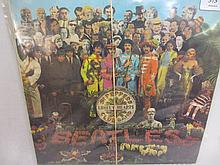 Six Beatles L.P.'s including: ' Sergeant Pepper ', ' Magical Mystery Tour ' with booklet, ' Revolver ', ' Rubber Soul ', ' Hard Days Night ' and ' Abbey Road '