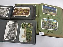 Three albums containing various postcards