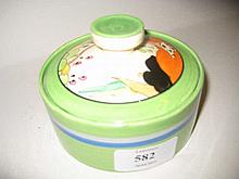 Clarice Cliff Bizarre circular preserve pot and cover, the cover painted in Secrets pattern