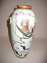 Art Union baluster form vase decorated with an exotic bird and flowers in oriental style