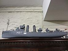 Painted wooden model of a battleship, H87