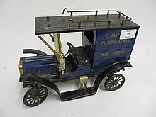 Tin plate model of a vintage car with Plumbing Service advertising