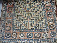 20th Century Turkish rug with tree of life design on an ivory ground with borders, 7ft x 5ft approximately