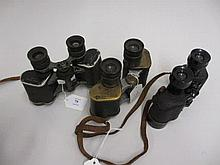 Pair of Taylor-Hobson military issue binoculars, dated 1943 together with a pair of American army issue binoculars, leather cased and a pair of Negretti and Zambra cased binoculars (a/f)
