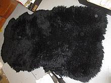 Large black sheepskin rug, 6ft x 3ft
