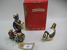 Royal Doulton Bunnykins figure postman with bike, together with a Royal Crown Derby paperweight in the form of a bird
