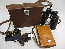 Cased pair of field glasses, pair of opera glasses and two cameras