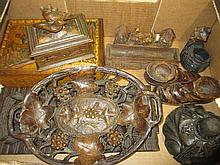 Small Black Forest jewellery box mounted with two carved figures of birds, a similar desk pen tray, another circular Black Forest carved inkwell, two handled carved wooden tray, folding carved wooden book rack, a wall shelf, pair of boots and four