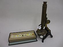 Henry Crouch, brass and black Japanned adjustable microscope together with a box containing a quantity of late 19th or early 20th Century mounted slides