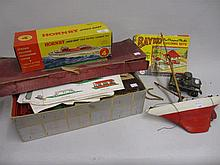 Hornby model IV clockwork speed boat in original box, small model pond yacht, tin plate toy tank, a boxed Tip Kick football game and a Bayko construction set
