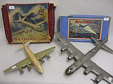 Friction drive model of a Vickers Viscount airliner in original box, together with a similar model of an American Super Fortress and a boxed board game, ' Aviation '