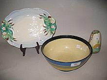 Clarice Cliff Bizarre bowl with painted decoration in horizontal bands, 22cms diameter (losses to paint) together with a Clarice Cliff Newport pottery floral decorated dish, and a sugar caster (a/f)