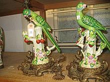 Pair of reproduction porcelain figures of parrots with ormolu candle mounts (one a/f)