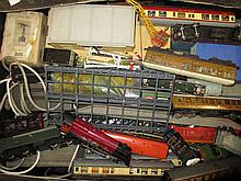 Box containing a large quantity of various 0 gauge mixed engines, carriages, rolling stock, buildings etc and another pine box containing a quantity of miscellaneous accessories etc