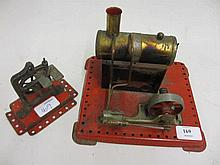 Mamod steam stationary engine together with another smaller model of a bench drill